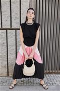 Faldas midi espectaculares: la inversión más pequeña para el efecto moda más grande (y de paso te quitan años y kilos)